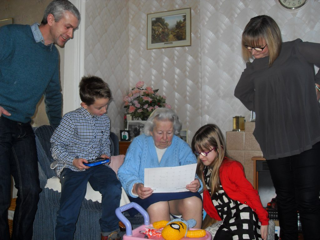 Nan opens her traditional Christmas Calendar alongside Eddie, Trina, Adam and Emma, December 2013.
