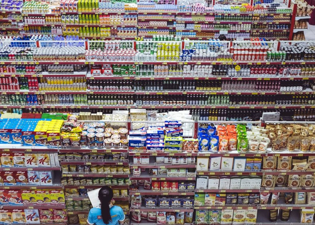 Mass consumption: stocked supermarket shelves