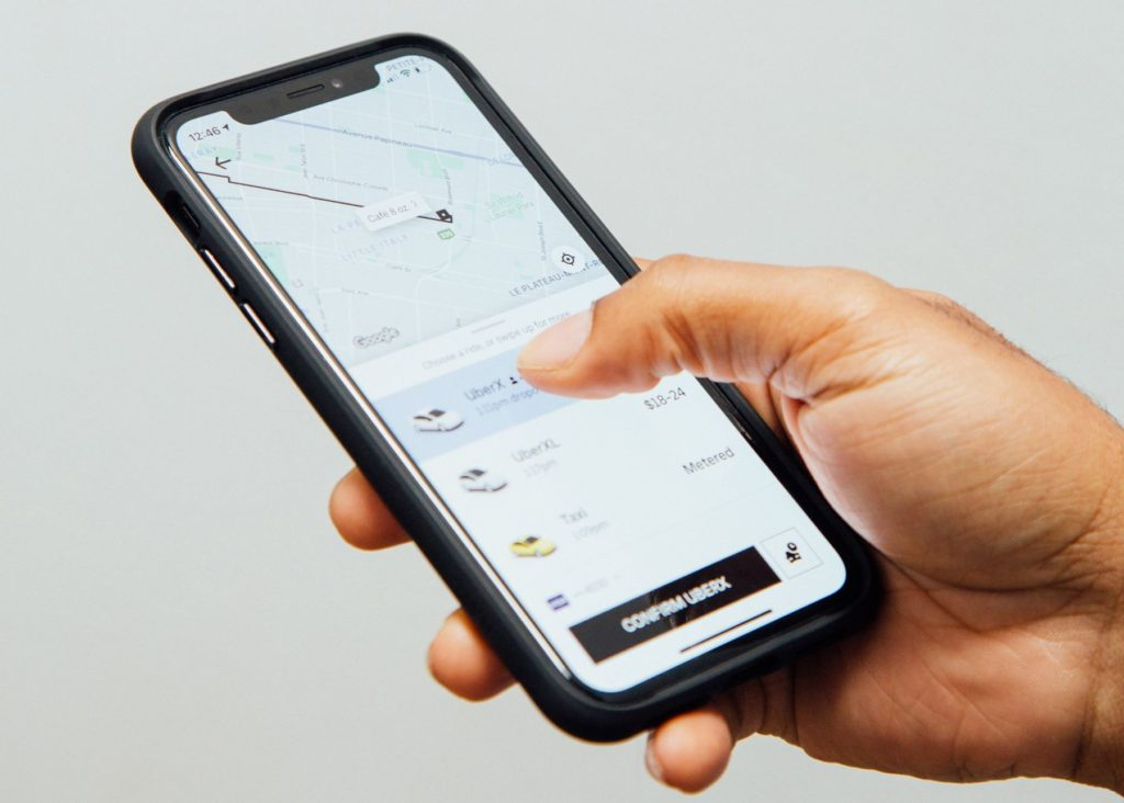 User booking taxi with Uber app